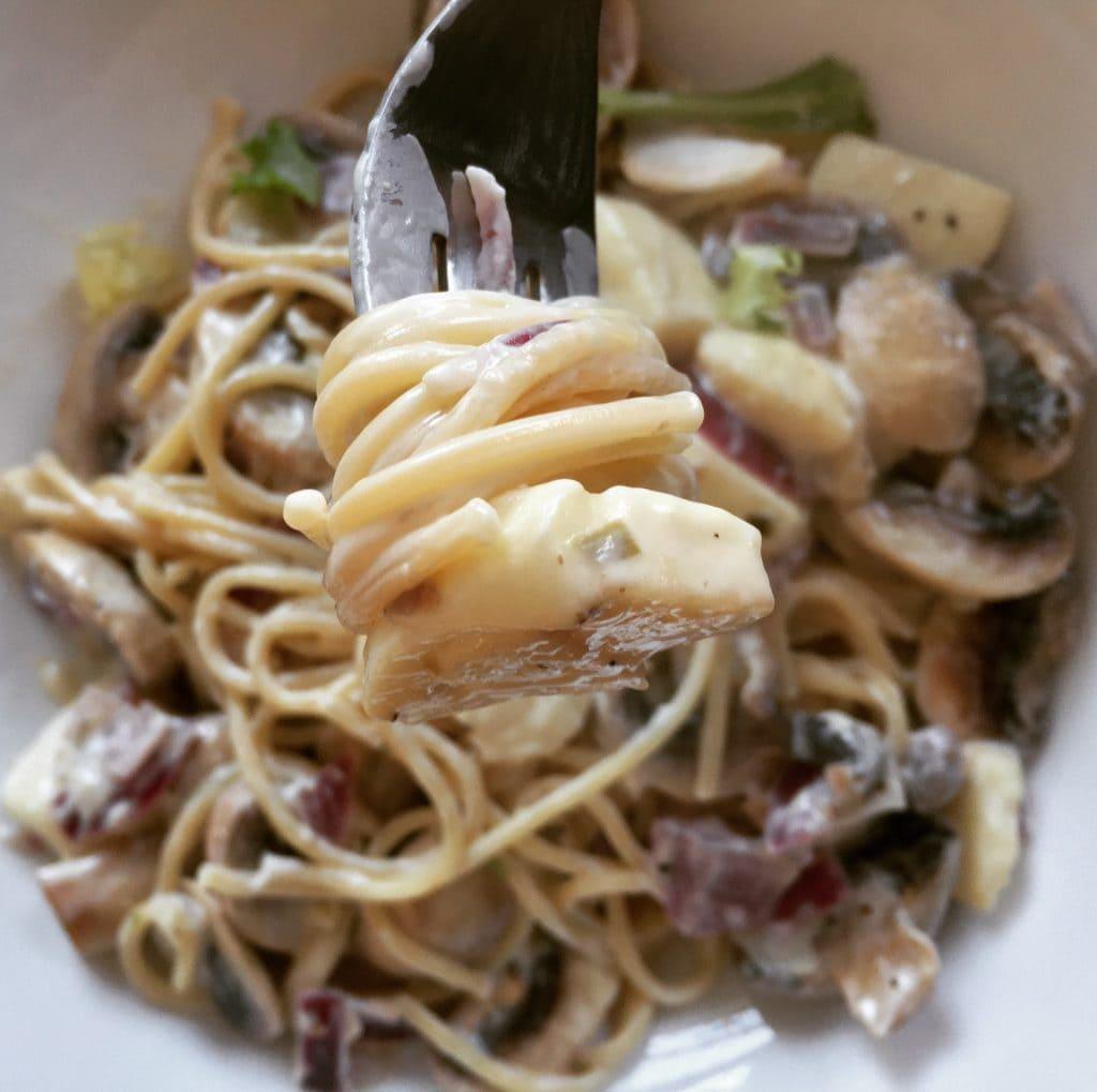 eating mushroom and halloumi spaghetti