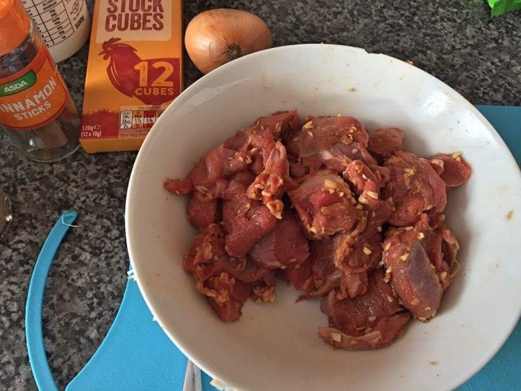 lamb and marinade in bowl