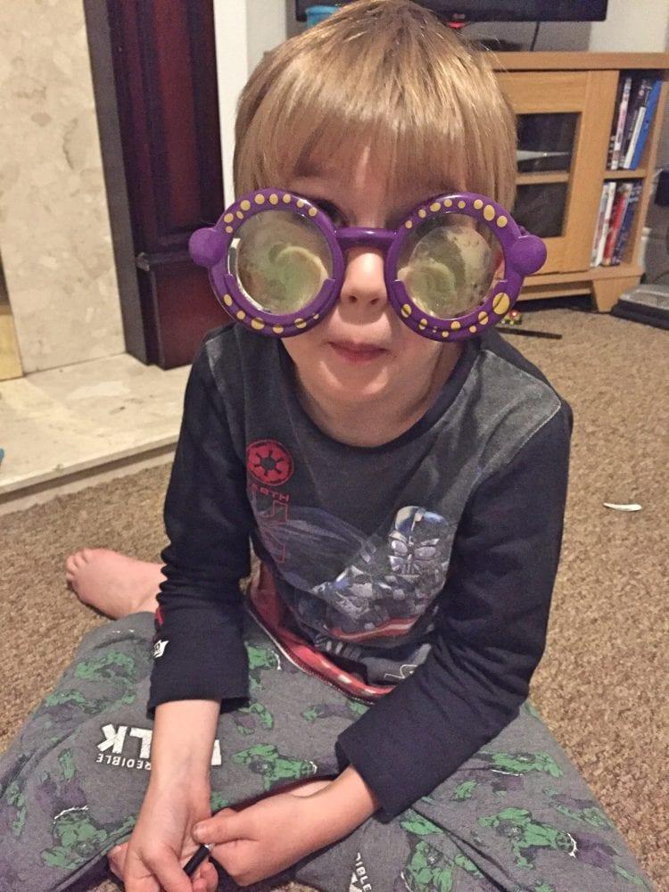 The Boy in google eye glasses