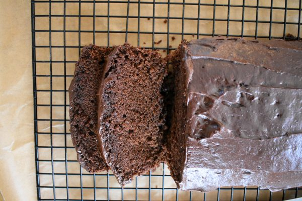 Top view of cake on wire rack, 2 slices falling from the rest